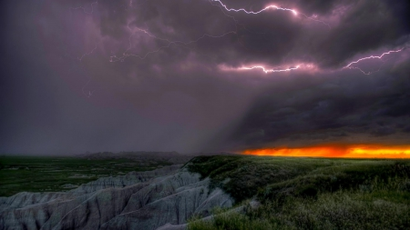 aggressive lightning storm over badlands - rocks, lightning, badlands, sunset, clouds, storm