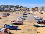 beached boats in low tide at st. ives england