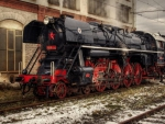 vintage steam locomotive in rail yard hdr