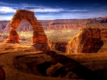 fabulous natural rock arch in a canyonl hdr
