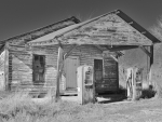 derelict texas gas station in grayscale