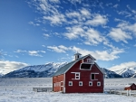 beautiful red barn on a farm in winter