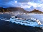 cruise ship sailing out of beautiful harbor
