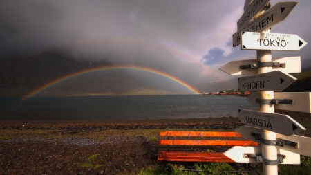 rainbow on a bay - signpost, bench, village, rainbow, clouds, bay