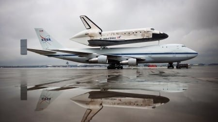 discovery shuttle on it's way to the air and space museum - shuttle, puddle, overcast, plane, tarmac, reflection