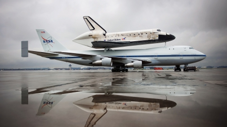 discovery shuttle on it's way to the air and space museum - plane, tarmac, puddle, reflection, overcast, shuttle