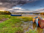 boats tied up in grassy waters hdr
