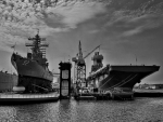 military ships at dry dock in b&w