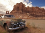 old buick at the end of the line in the desert