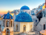 blue domes on a church in a greek town