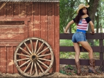 Cowgirl Outside A Red Barn