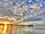 long sea pier in bright sunrise hdr