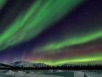 beautiful northern lights over alskan winter landscape