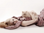 Model lying with cat