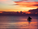 sailboat on a lonely sea at sunset