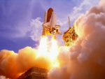 the shuttle atlantis taking off
