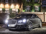 bentley continental gt at a mansion