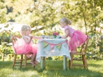 Two little girls having a tea party