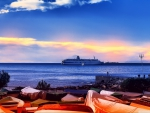 boats covered shore looking onto cruise ship