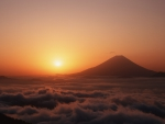 volcano above the clouds at sunset