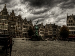 storm clouds over city square in antwerp belgium hdr