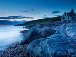 blue grey rocky seashore at twilight