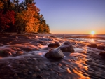 sunrise over hurricane river into lake superior in michigan