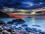 superb rocky seashore at red twilight hdr
