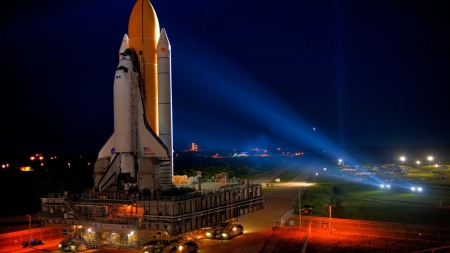 the shuttle discovery moving to launch pad - tractor, night, pad, shuttle, lights
