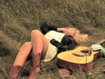 Cowgirl Lying In A Field