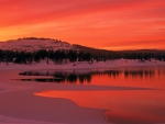 red sunset over california reservoir in winter