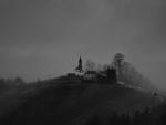 magical rural hilltop church in grayscale