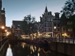 evening on an amsterdam street canal
