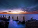 beautiful sky over rocky seashore