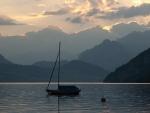 sailboat on an alpine lake at sundown