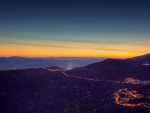 mountainside town at twilight