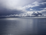 Calm sea with clouds on the horizon