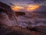 *Beautiful sunset over a stormy ocean *