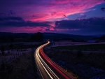 light on highway in long exposure at twilight