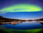 aurora borealis over a tranquil lake