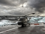 helicopter on a carrier in rough seas