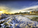 sunset over train track in winter hdr