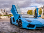 a baby blue lamborghini aventador in paris