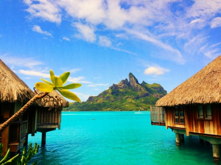 Holidays In Bora Bora - resort, international tourist, beautiful, clouds, volcano, lagoon, mountain, French Polynesia, paradise, island, barrier reef, emerald waters