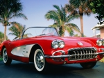 a classic red convertible chevrolet corvette