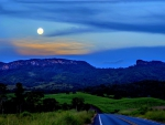 highway to mountains under moonlight