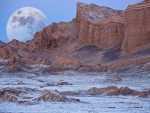wonderful moon behind desert mountains