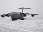 c-17 globemaster on a tarmac in snow strm