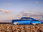sparkling blue hot rod chevy in the desert