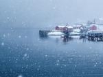 snow storm over norwegian seaside village